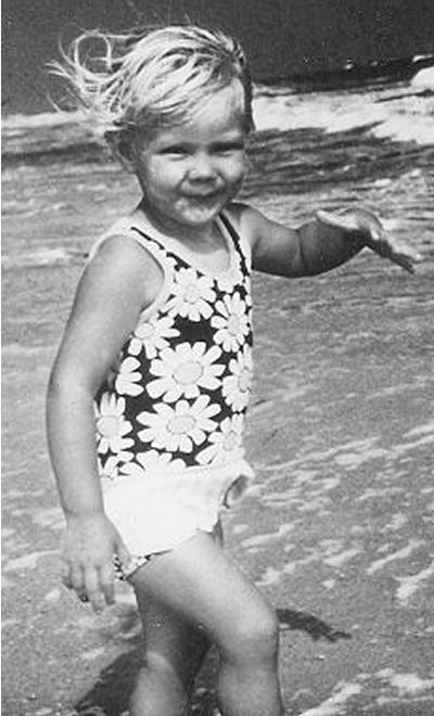 Kristen at the beach. She was our little tiger.